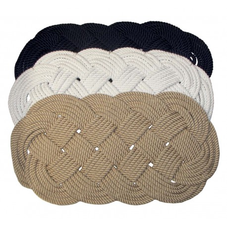Oval hand-woven rug in solid colour
